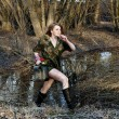 Military woman running in the forest — Stock Photo