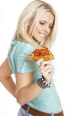 Portrait of young woman with pizza over white background — Stock Photo