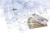 Money and receipts — Stock Photo
