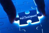 Web development on puzzle piece — Stock Photo