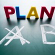 Crossing out Plan A and writing Plan B. — Stock Photo