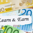 Learn and earn concept and euro notes - Stock Photo