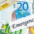 Emergency on financial concept with euro notes - Stock Photo