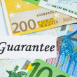 Guarantee on financial concept with euro notes - Stock Photo