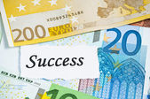 Success on finance concept with euro notes — Stock Photo