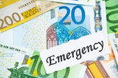 Emergency on financial concept with euro notes — Stock Photo