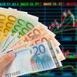 Stock Photo: Euro notes with sotck or exchange trade data analysis