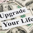 Upgrade your life by money - Stock Photo