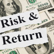 Risk and return words on hundreds US notes - Stock Photo