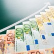 Euro banknotes and growing arrow - Stock Photo