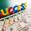 Colorful success words and growing US dollars - Stock Photo
