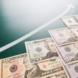 American banknotes and growing arrow - Stock Photo