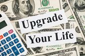Upgrade your life, words and calculator — Stock Photo