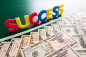 Colorful success words and growing US dollars — Stock Photo
