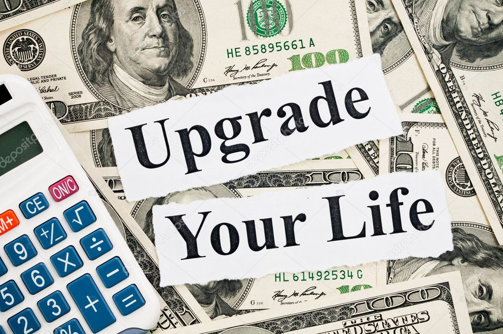 Upgrade your life, words and calculator on hundreds US notes background — Stock Photo #9045612