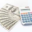 American hundreds dollars and calculator — Stock Photo #9061876