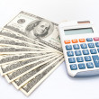 Stock Photo: Americhundreds dollars and calculator