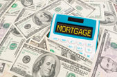 Mortgage word on calulator with American notes — Stock Photo