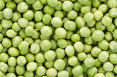 Full of fresh green peas — Stock Photo