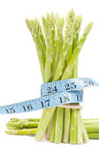 Lose weight concept, Asparagus with tape — Stock Photo