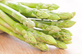 Asparagus bundle on wooden background — Stock Photo
