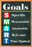 Smart goal setting colorful letters on grungy blackboard — 图库照片