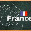 Stock Photo: France map and flag draw on blackboard