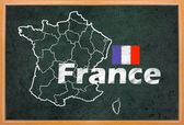 France map and flag draw on blackboard — Stock fotografie