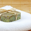 Hand-made soap in wellness still life — Stock Photo