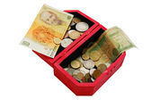 Old banknotes and coins in wooden casket — Stock Photo