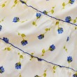 Stock Photo: Yellow cloth with pattern of flowers