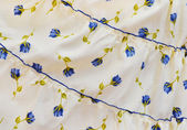 Yellow cloth with pattern of flowers — Stock Photo