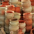 Pots in the window of a potter's workshop — Stock Photo