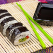 Sushi on a bamboo mat — Stock Photo