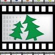 Vector film strip with christmas trees — Stock Vector