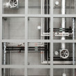 Industrial pipes and fans on ceiling — Stock Photo #8017511