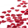 Confetti hearts on white background — Stock Photo