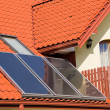 Solar panels on roof of house — Stock Photo #8017897