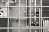 Industrial pipes and fans on ceiling — Stock Photo