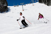 Two skiers downhill skiing — Stock Photo