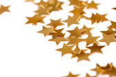 Christmas decoration of golden confetti stars — Stock Photo