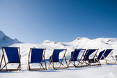 Empty deckchairs in alps — Stock Photo