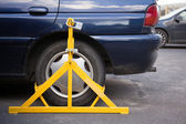 Car weel clamped — Stock Photo