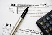 Filling up tax form 1040 — Stock Photo
