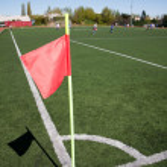 Red flag in corner of soccer field — Stock Photo #8598027