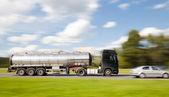 Petrol tanker truck in motion blur — Stock Photo