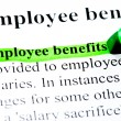 Employee benefits definition highlighted by green marker on white — 图库照片