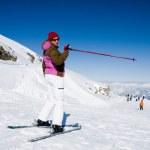 Woman pointing ski slope — Stock Photo #8746151