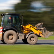 Stock Photo: Bulldozer fast blurred motion