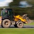 Bulldozer fast blurred motion — Stock Photo